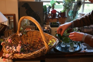 Here Christopher is effortlessly placing greens into the vases.